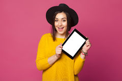 Smiling woman showing tablet computer screen Royalty Free Stock Photography
