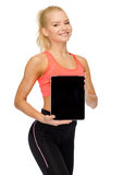 Smiling woman showing tablet pc blank screen Stock Photo