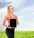 Smiling woman showing tablet pc blank screen Stock Photography