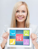 Smiling woman showing tablet pc computer screen Royalty Free Stock Photos