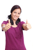 Smiling woman showing thumbs up Stock Photo