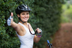 Smiling woman showing thumbs up Royalty Free Stock Images