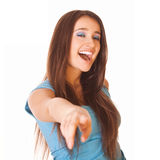 Smiling woman shows forward at you Stock Image