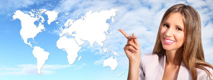 Smiling woman shows the international map Royalty Free Stock Image