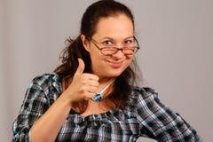 Smiling woman shows okay Stock Image