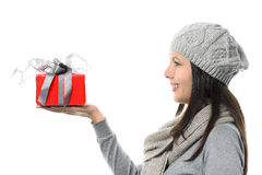 Smiling Woman in Side View Showing Gift on Hand Royalty Free Stock Image