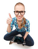 Smiling woman sitiing on floor with tablet pc Stock Photo