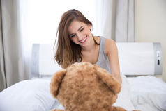 Smiling woman sitting on the bed Stock Image