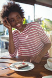 Smiling woman sitting in cafe Stock Image