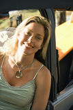 Smiling Woman Sitting in Car Stock Images