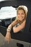 Smiling Woman Sitting in Car Royalty Free Stock Images