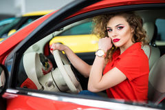 Smiling woman sitting in car Royalty Free Stock Photo