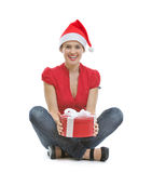 Smiling woman sitting with Christmas present box Royalty Free Stock Images