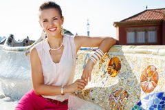 Smiling woman sitting on the famous trencadis style bench Royalty Free Stock Images