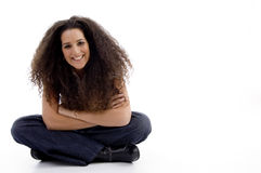 Smiling woman sitting on the floor Royalty Free Stock Image