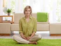 Woman on living room floor Royalty Free Stock Images
