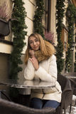 Smiling woman sitting in restaurant ,decorated for the Christmas Royalty Free Stock Images