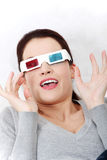 Smiling woman sitting on a sofa with 3D glasses. Stock Photography