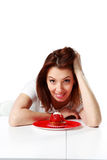Smiling woman sitting at the table with fresh strawberry cake Stock Image