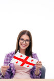 Smiling woman sitting at the table with Georgians flag Royalty Free Stock Photography