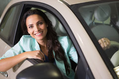 Smiling woman sitting at the wheel of her new car Stock Photography