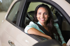 Smiling woman sitting at the wheel of her new car Stock Image
