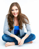 Smiling woman sitting on a white floor. Stock Photo