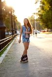 Smiling woman skating during sunset Royalty Free Stock Photos