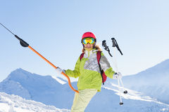 Smiling woman in ski suit lifting on button lift Royalty Free Stock Image