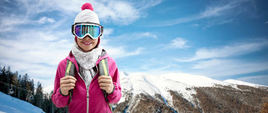 Smiling woman in ski suit Royalty Free Stock Images