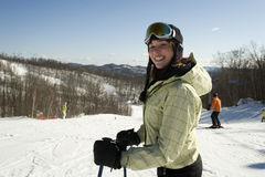 Smiling woman skiing on hill Royalty Free Stock Photos