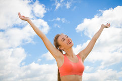 Smiling woman on the sky background Royalty Free Stock Photo