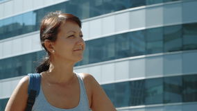 Smiling woman at the skyscraper background stock footage