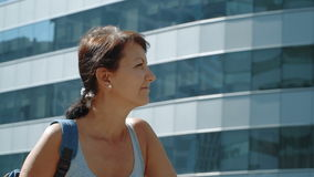 Smiling woman at the skyscraper background stock video footage