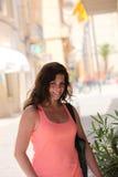 Smiling Woman in Sleeveless Pink Orange Shirt stock photos