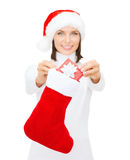 Smiling woman with small giftbox and stocking Royalty Free Stock Photo