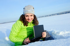 Smiling woman with small laptop Stock Image
