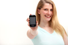 Smiling woman with smartphone Royalty Free Stock Photo