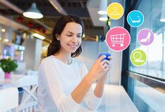 Smiling woman with smartphone shopping online Stock Image