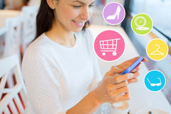 Smiling woman with smartphone shopping online Stock Images