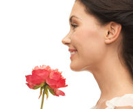 Smiling woman smelling flower Royalty Free Stock Image