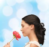 Smiling woman smelling flower Stock Photography