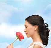 Smiling woman smelling flower Royalty Free Stock Images