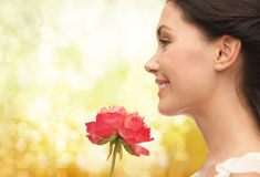 Smiling woman smelling flower Royalty Free Stock Photos