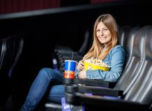 Smiling Woman With Snacks At Cinema Theater Royalty Free Stock Photo