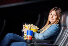 Smiling Woman With Snacks At Movie Theater Stock Photo