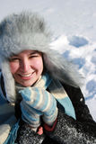 Smiling woman on the snow Royalty Free Stock Photography