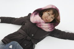 Smiling woman in snow Stock Photo