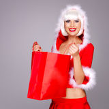 Smiling woman in snow maiden suit holds the shopping bags Stock Photo