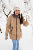 Smiling woman in snow outside Stock Images